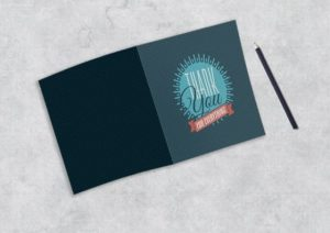 folded thank you cards gray background