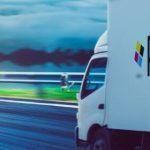 company truck driving towards the sunlight