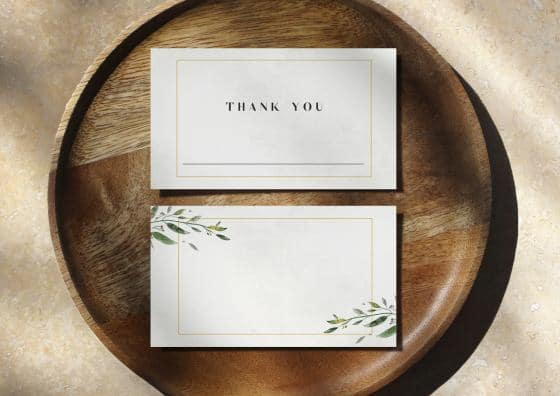 place cards on top of wooden plate